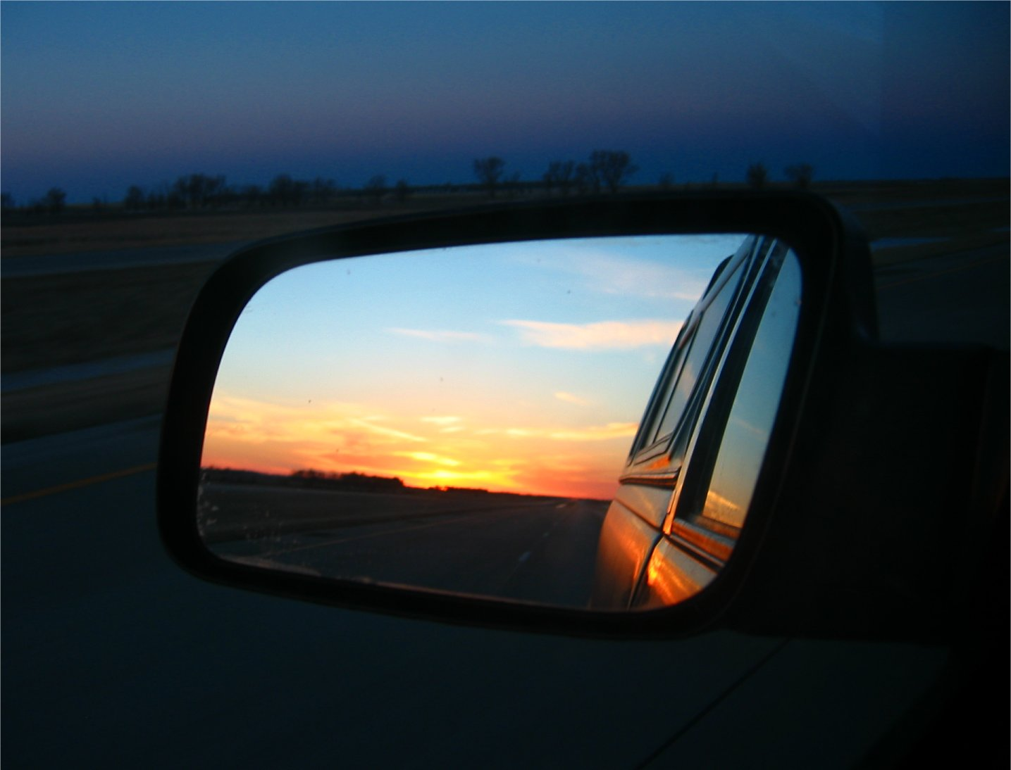 Sun rising in the rearview mirror - I94 - North Dakota - March 2005 - soul-amp.com