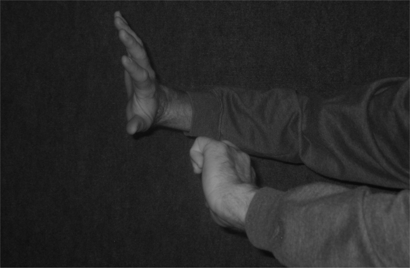 BW - Shoving hands against a grey background - soul-amp.com